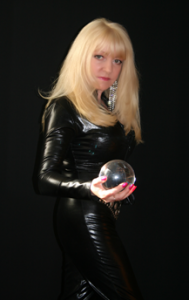 Mistress Marisa holding a crystal ball